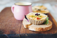 Fresh Quiche lorraine. Close-up of Quiche lorraine with mug of milk on the old wooden board Stock Images