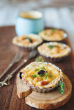Fresh Quiche lorraine. Close-up of Quiche lorraine with mug of milk on the old wooden board Stock Photo