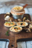 Fresh Quiche lorraine. Close-up of Quiche lorraine with thyme and dried mushrooms on the old wooden board Stock Image