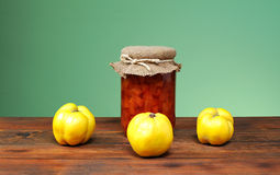 Fresh quince jam in a jar and glass. On the table Royalty Free Stock Image