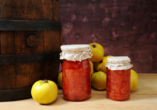 Fresh quince and jam in a jar. On the table Stock Photography