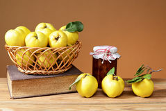 Fresh quince jam in a jar. On the table Royalty Free Stock Photos