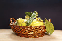 Fresh quinces. In a crate Stock Photos