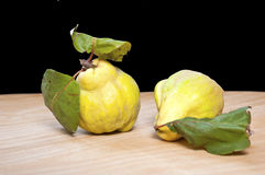 Fresh quinces. On a wooden board Royalty Free Stock Image