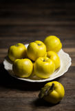 Fresh quinces. On the wooden table Royalty Free Stock Photos