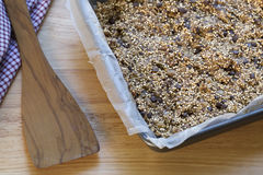 Fresh Quinoa Breakfast Bars. Quinoa baking bars in baking pan and spatula Royalty Free Stock Images