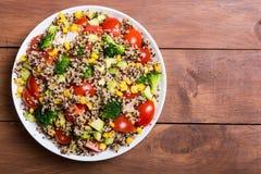 Fresh quinoa salad. Quinoa salad with tomatoes , avocado , broccoli and corn . Vegan superfood Royalty Free Stock Photos