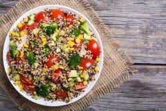 Fresh quinoa salad. Quinoa salad with tomatoes , avocado , broccoli and corn . Vegan superfood Royalty Free Stock Image