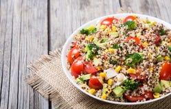 Fresh quinoa salad. Quinoa salad with tomatoes , avocado , broccoli and corn . Vegan superfood Stock Photography