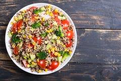 Fresh quinoa salad. Quinoa salad with tomatoes , avocado , broccoli and corn . Vegan superfood Royalty Free Stock Images