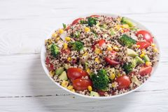 Fresh quinoa salad. Quinoa salad with tomatoes , avocado , broccoli and corn . Vegan superfood Stock Photo