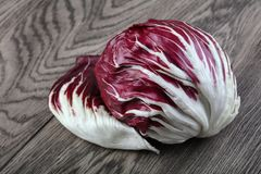 Radicchio salad. Fresh Radicchio salad on the wood background Royalty Free Stock Photo