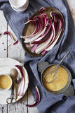 Fresh radicchio treviso quality on tray and cornmeal flour for preparing polenta on table with cloth Stock Image