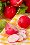 Fresh radish. Fresh cut garden radish on a yellow napkin Stock Images