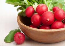 Fresh radish. In wooden bowl Stock Image