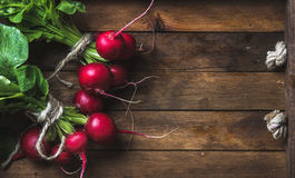 Fresh radish banches on wooden tray background, copy space Stock Photo