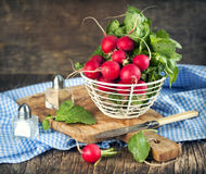 Fresh radish. In basket on wooden table Royalty Free Stock Photography