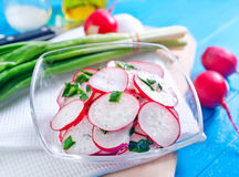 Fresh radish. In bowl and on a table Stock Photo