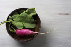 Fresh radish on bowl white wooden table Stock Photography