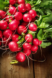 Fresh radish bunch on rustic wooden background. Fresh just picked radish on rustic wooden background. Close-up, copy space. Selective focus Stock Photo