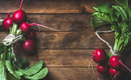Fresh radish bunches over rustic wooden background, copy space. Fresh radish bunches over rustic wooden background, top view, copy space, horizontal composition Stock Images