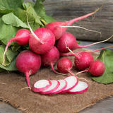 Fresh radish. On burlap background Royalty Free Stock Photos