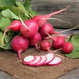 Fresh radish. On burlap background Royalty Free Stock Photos