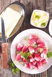 Fresh radish and butter. On wood background Royalty Free Stock Image