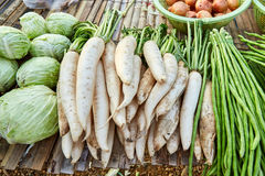 Fresh radish, cabbage and yardlong bean. On bamboo litter. Vegetables sold in local market Royalty Free Stock Photo