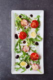 Fresh radish, cherry tomato, quail egg, ruccola with balsamic glaze on a white plate. Mediterranean lifestyle. Healthy. Food Royalty Free Stock Images