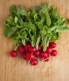 Fresh radish on cutting board. Top view Stock Image