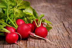 Fresh radish on dark wooden background Stock Photo