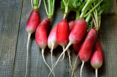 Fresh radish. On wooden table. Vegetarian food Royalty Free Stock Photography