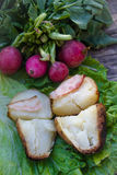Fresh radish and fried potato with beacon with salad. On wooden table Stock Photos