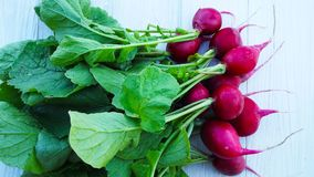 Fresh radish from the garden. Fresh radish from the garden on a wooden background Stock Photo