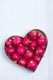 Fresh radish  in heart shape Stock Photos
