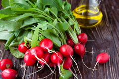 Fresh radish with leaves on the boardsand cooking oil Royalty Free Stock Photography