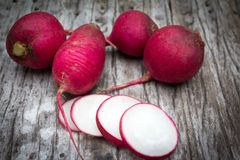 Fresh radish on old wooden. Table Royalty Free Stock Image