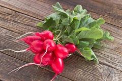 Fresh radish on old wooden table. Fresh radish on old old wooden table Stock Image