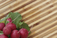 Fresh radish. Es on a wooden table Royalty Free Stock Photography