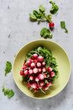 Young radish in a bun. Fresh spring vegetables. Salad. Healthy food. Fresh radish ready to eat in salad. Healthy food Stock Photo