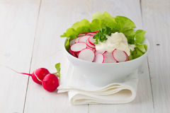 Fresh radish salad in a bowl. On wooden table Stock Photos