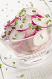 Fresh radish salad with chives. In a glass bowl Royalty Free Stock Photography