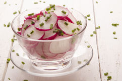 Fresh radish salad with chives. In a glass bowl Royalty Free Stock Photo