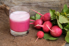 Fresh radish smoothy juice. On burlap Royalty Free Stock Photography