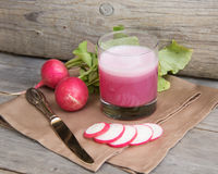 Fresh radish smoothy juice. On wood Stock Photography