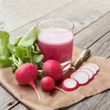 Fresh radish smoothy juice. Fresh radish smoothy  juice on wood Royalty Free Stock Image
