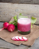 Fresh radish smoothy juice. On wood Stock Photo