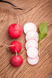 Fresh radish vegetables. Fresh radish on old wooden table. Natural food Royalty Free Stock Images