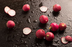 Fresh radish in a wet background. Fresh radish in a wet background Royalty Free Stock Photo